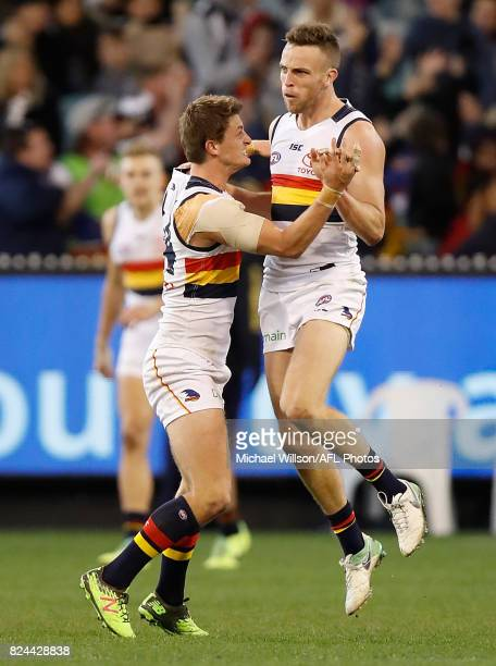 Brodie Smith and Matt Crouch of the Crows celebrate during the 2017 AFL round 19 match between the Collingwood Magpies and the Adelaide Crows at the...