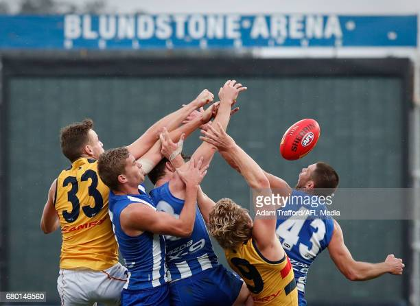 Brodie Smith and Rory Sloane of the Crows compete for the ball with Jed Anderson and Sam Gibson of the Kangaroos during the 2017 AFL round 07 match...