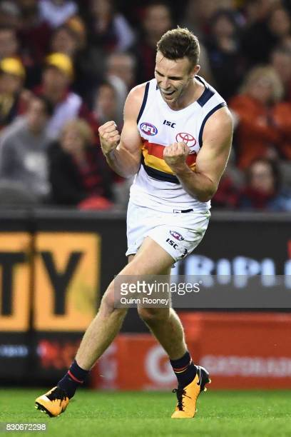 Brodie Smith of the Crows celebrates kicking a goal during the round 21 AFL match between the Essendon Bombers and the Adelaide Crows at Etihad...