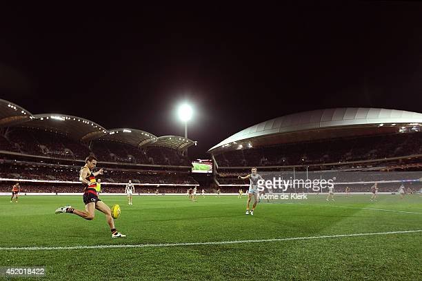 Brodie Smith of the Crows clears the ball during the round 17 AFL match between the Adelaide Crows and the Hawthorn Hawks at Adelaide Oval on July 11...