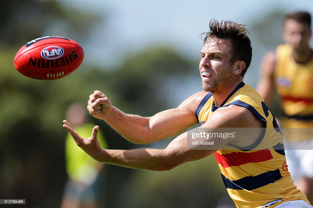 Brodie Smith of the Crows handballs during the 2016 AFL NAB Challenge match between the Fremantle Dockers and the Adelaide Crows at Sounness Park on February 28, 2016 in Perth, Australia.