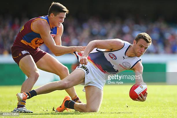 Brodie Smith of the Crows is tackled by Jack Crisp of the Lions during the round 20 AFL match between the Brisbane Lions and the Adelaide Crows at...