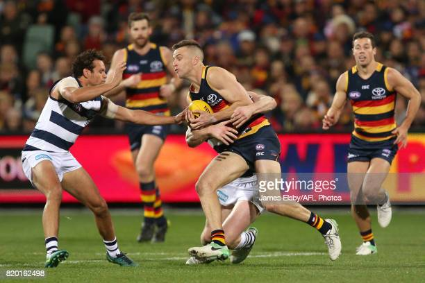 Brodie Smith of the Crows is tackled by Patrick Dangerfield of the Cats during the 2017 AFL round 18 match between the Adelaide Crows and the Geelong...
