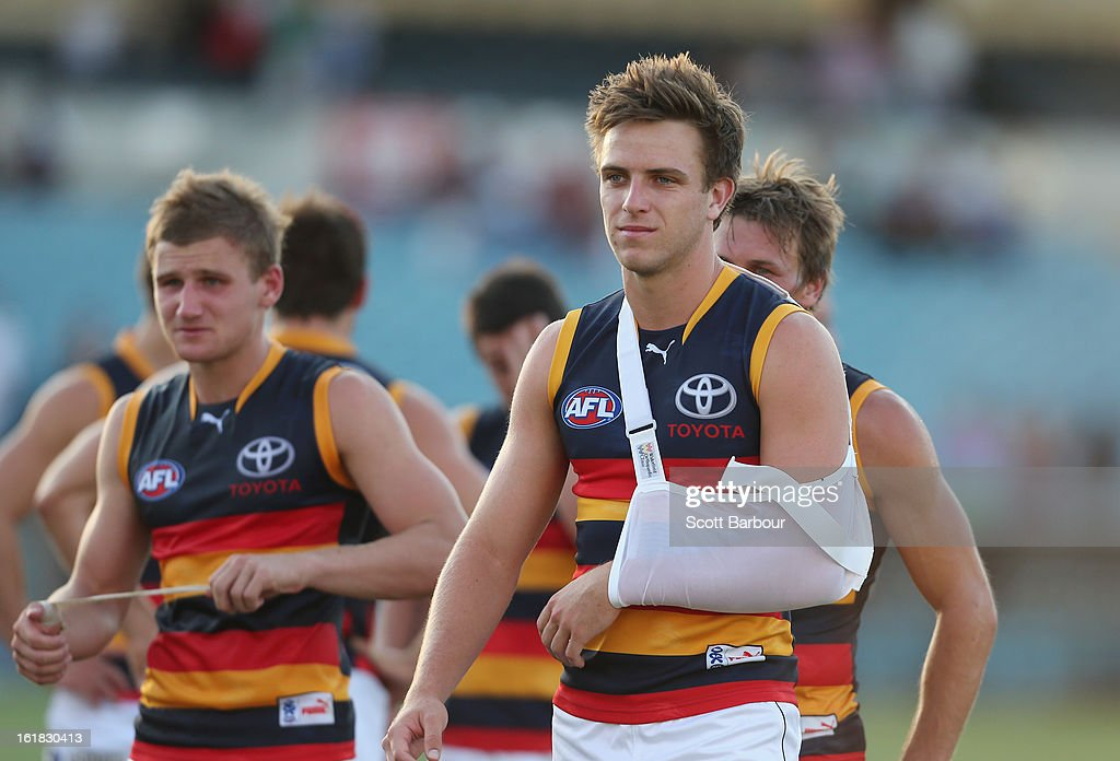 Brodie Smith of the Crows leaves the ground injured after the round one AFL NAB Cup match between the Adelaide Crows and the Port Adelaide Power at AAMI Stadium on February 17, 2013 in Adelaide, Australia.