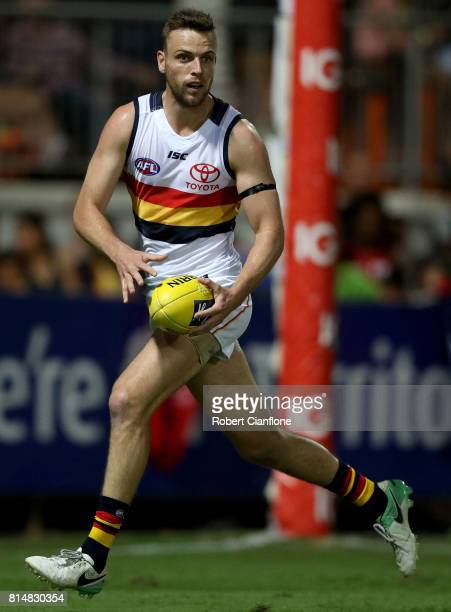Brodie Smith of the Crows runs with the ball during the round 17 AFL match between the Melbourne Demons and the Adelaide Crows at TIO Stadium on July...