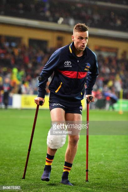 Brodie Smith of the Crows walks from the field at half time with a suspected knee injury during the AFL First Qualifying Final match between the...