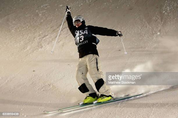 Brodie Summers of Australia celebrates after crossing the finish line to place third in the Men's Dual Moguls during the FIS Freestyle World Cup at...