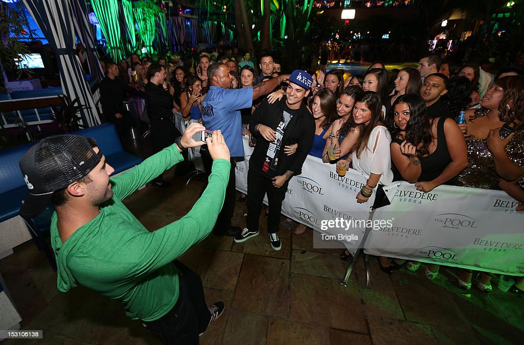 Brody Jenner (L) and Rob Kardashian take pictures with fans while hosting The Pool After Dark at Harrah's Resort on Saturday September 29, 2012 in Atlantic City, New Jersey.