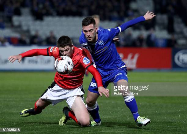 Brody Taylor of Edgeworth Eagles and Nicholas Epifano of South Melbourne compete for the ball during the FFA Cup round of 32 match between South...