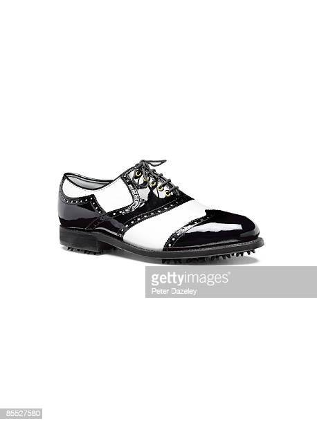 Brogue golf shoe on white background.