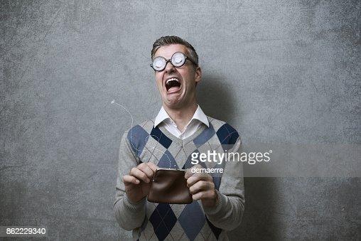 Broke man with empty purse : Foto de stock