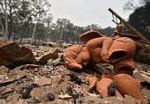 A broken angel statue sits amidst rubble from a burned out house in the Valley fire in Middletown California on September 13 2015 The governor of...