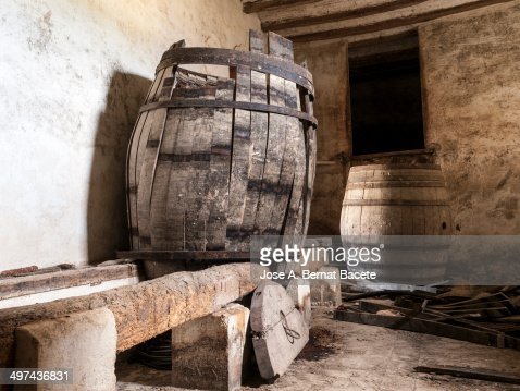 http://media.gettyimages.com/photos/broken-barrels-in-a-wine-cellar-old-picture-id497436831?s=170667a