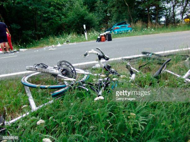 Broken bicycles and debris litter the scene of a fatal accident involving some of Australia's top women cyclists near the town of Gera on July 18...