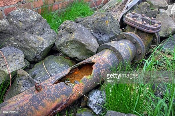 Broken cast iron water pipe