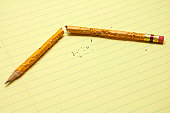 Broken Chewed Pencil On Notepad