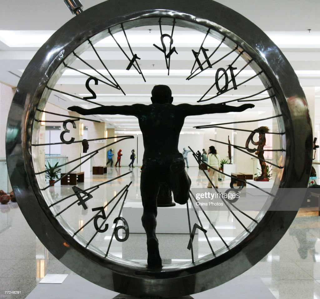A broken clock features in the work by sculptor Sun Shaoqun entitled 'Beyond Space Time' at the 2nd China Documentary Exhibition of Fine Arts on October 9, 2007 in Wuhan of Hubei Province, China. Sun, born in 1952, is known for his sculptures in urban areas. About 80 artists are displaying their art during the event with the theme 'Forms of Concepts: The Reform of Concepts of Chinese Contemporary Art 1987 - 2007'.