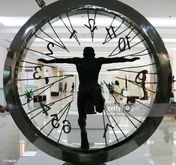 A broken clock features in the work by sculptor Sun Shaoqun entitled 'Beyond Space Time' at the 2nd China Documentary Exhibition of Fine Arts on...