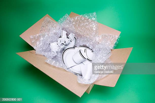 Broken dishes in cardboard box