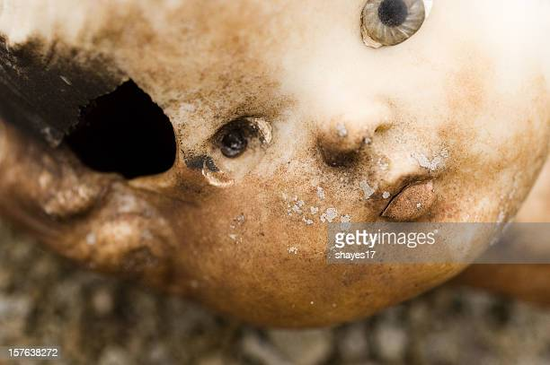 Broken doll head