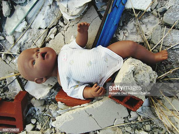 Broken Doll In Demolished Building
