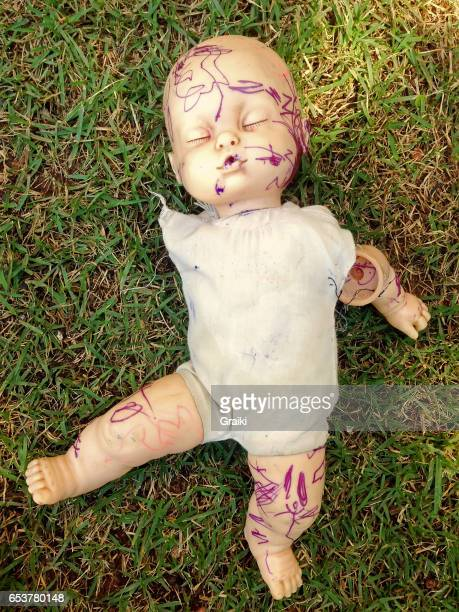 Broken Doll in the grass