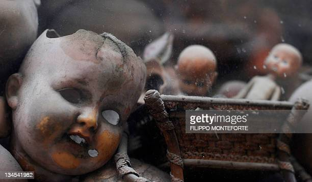 Broken dolls are displayed in the shop window of the restorer shop 'Restauri Artistici Squatriti' on December 2 2011 in Rome Local associations say...