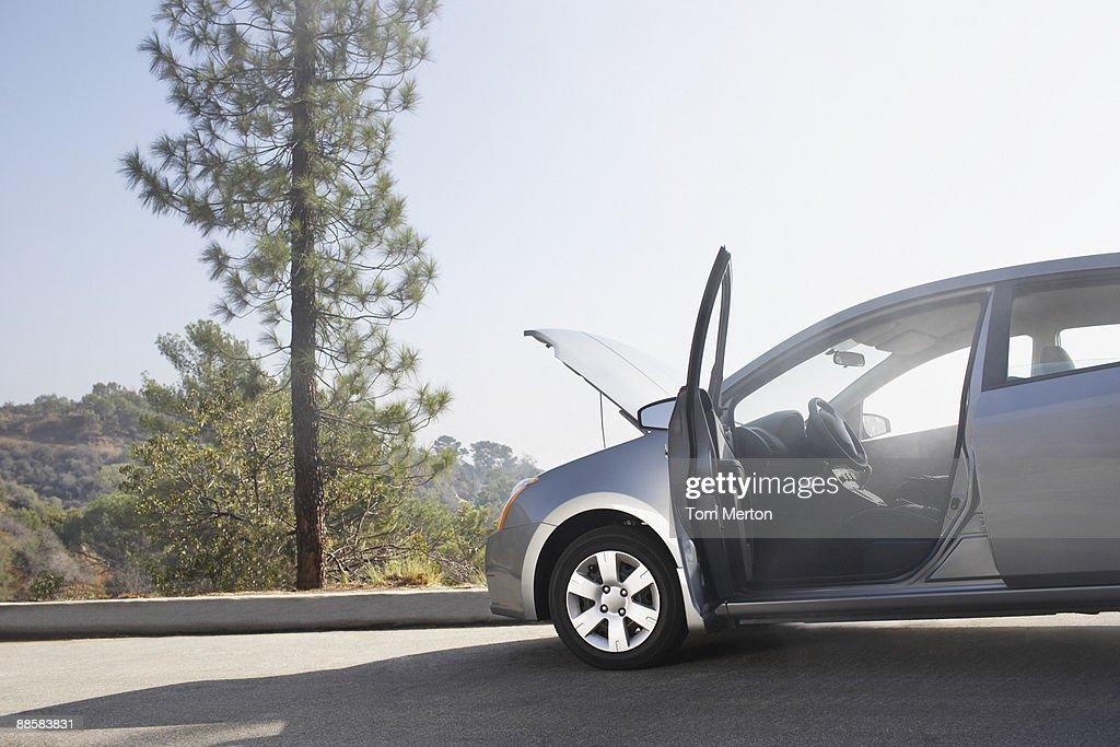 Broken down car on side of road