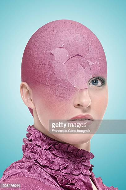 Broken egg shell on head
