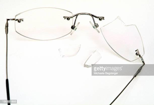 Broken eyeglasses, breakage of glass
