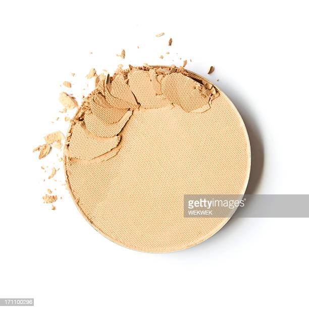 Broken face powder on white background