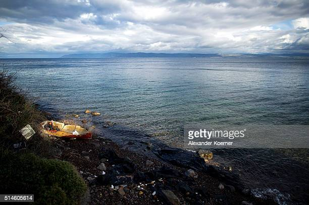 A broken fishing boat and life vests are seen on shore on March 10 2016 in Skala Sikamineas Greece The village of Skala Sikamnieas is located 60...