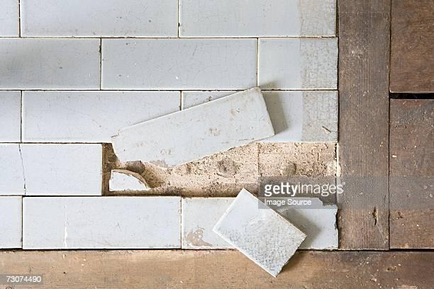 Broken floor tiles