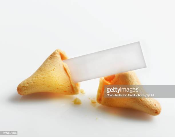 Broken fortune cookie with blank fortune paper inside