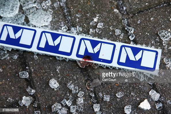 Broken glass and blood is seen beside signage outside an entrance to Maelbeek metro station following todays attack on March 22 2016 in Brussels...