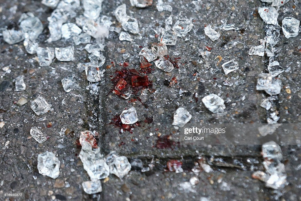 Broken glass and blood is seen outside an entrance to Maelbeek metro station following todays attack on March 22 2016 in Brussels Belgium At least 31...
