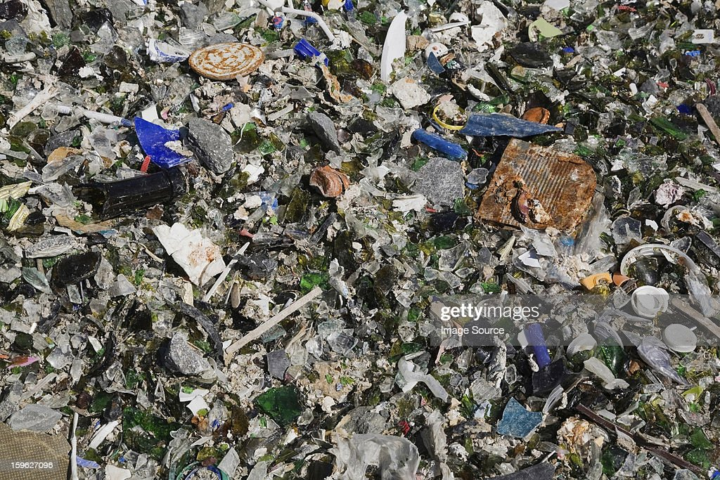 Broken glass and other debris at waste management site : Stock Photo