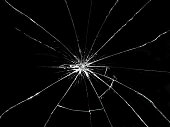 Broken glass on black background. Textured abstract backdrop