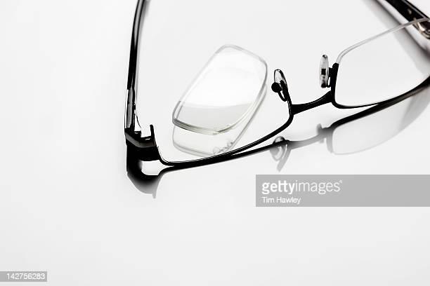 Broken glasses on white background