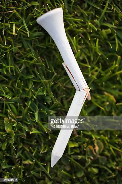 A broken golf peg on the grass, Sweden.