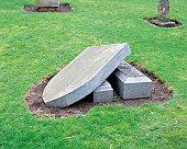 Broken headstone in graveyard