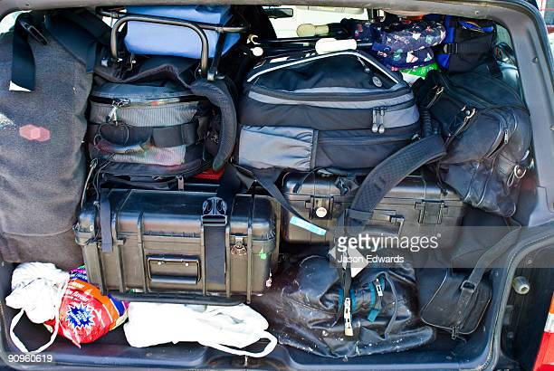 A photographers camera equipment and luggage crammed into an SUV.