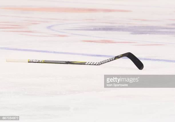 A broken hockey stick lies on the ice during the second period in a game between the Columbus Blue Jackets and the Toronto Maple Leafs on April 9 at...
