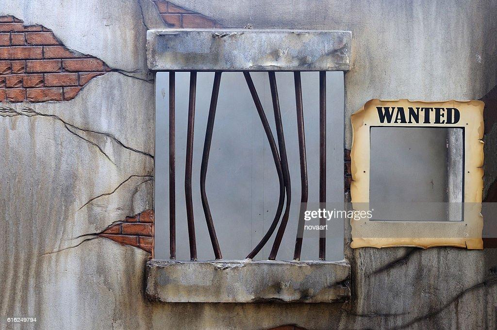 Broken jail with empty placard held : Foto de stock