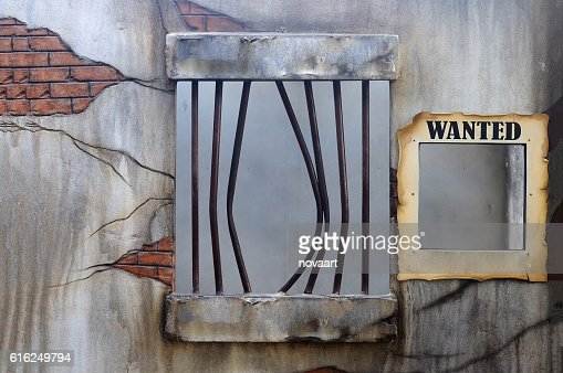 Broken jail with empty placard held : Foto de stock