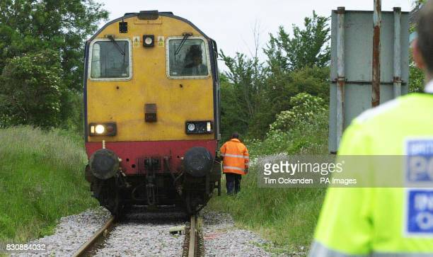 A broken light on the front of an engine is the only sign of damage to the train carrying an empty nuclear flask that was in collision with a lorry...