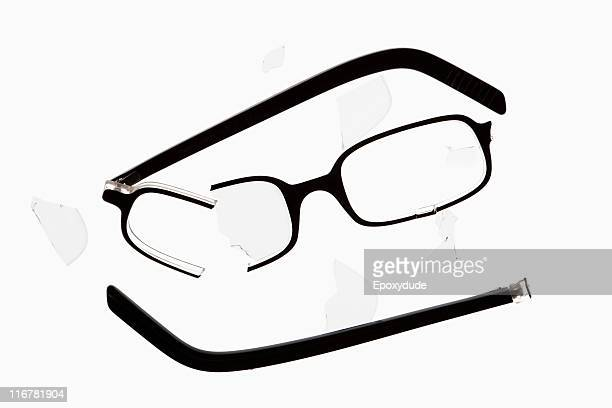A broken pair of glasses