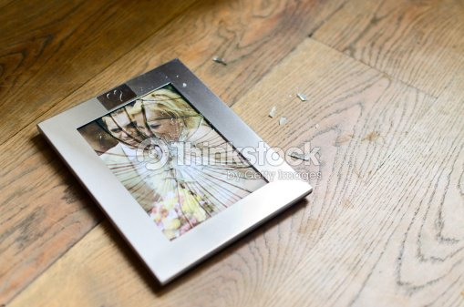 Broken Picture Frame With Married Couple Stock Photo | Thinkstock