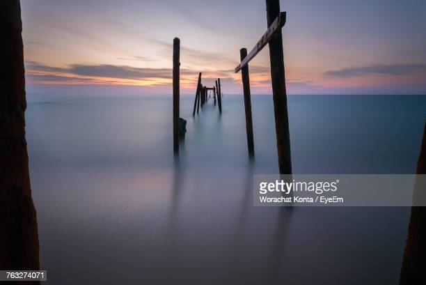 Broken Pier On Sea During Sunset
