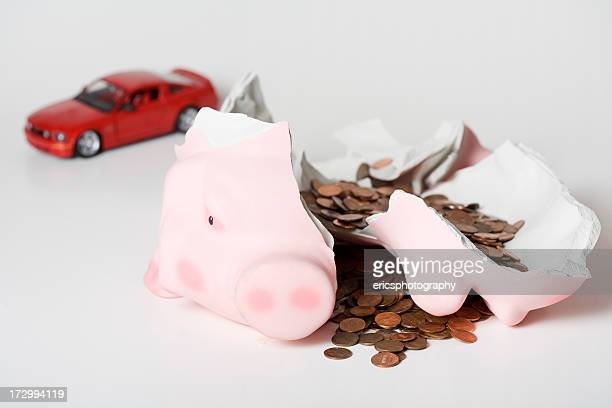 Broken piggy bank and car model